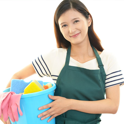 Woman holding bucket full of cleaning products